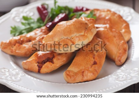 Baked empanadas, popular Latin American food served as snack or appetizer - stock photo