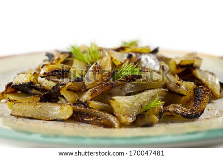 Baked fennel slices  on white background - stock photo