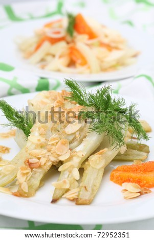 Baked fennel with almonds and oranges. Shallow dof