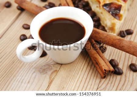 baked food : apple pie triangles served with hot coffee cup on wood table