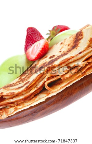 baked food : pancake with honey strawberries and apple isolated on white background . shallow dof - stock photo