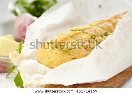 Baked garlic bread with herbs - stock photo