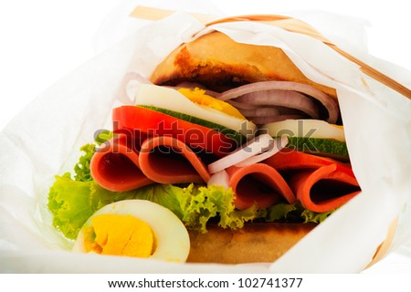Baked garlic ciabatta sandwich with fresh salad tomato onion egg and sausage as supplement