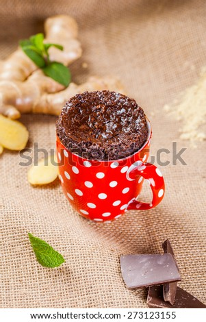 Baked ginger chocolate in a red cup - stock photo