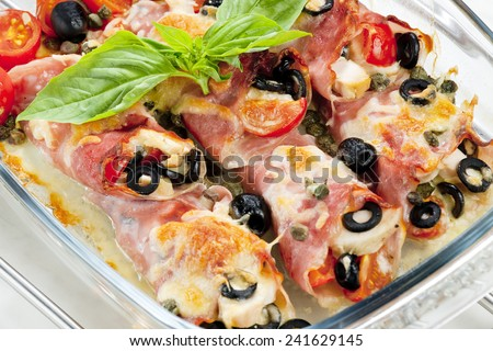 baked ham rolls filled with chicken meat and black olives