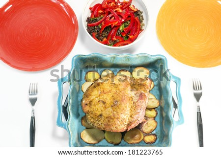 baked ham with potatoes and salad with paprika and fresh herbs - stock photo