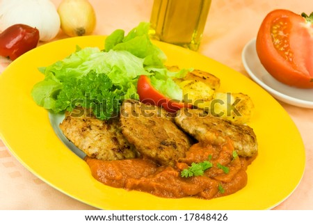 baked hamburger with tomato sauce,fried potatoes ,salad