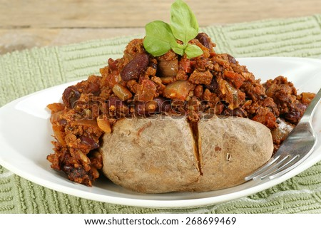 baked jacket potato topped with vegetarian chili