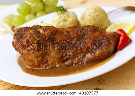 baked leg of goose with dumplings,salad - stock photo