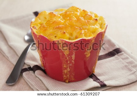 Baked macaroni and cheese, made with cheddar cheese. - stock photo