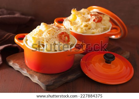 baked macaroni with cheese in orange casserole - stock photo