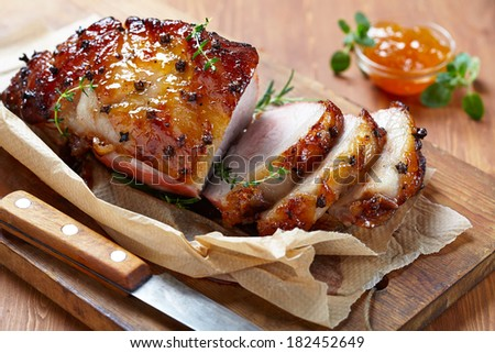 Baked meat with orange fruit jam and allspice - stock photo