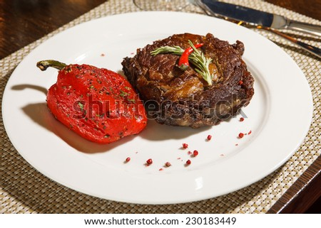 baked meat with pepper and rosemary