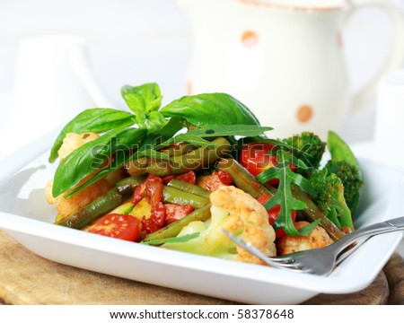 Baked mixed vegetable with herbs - stock photo
