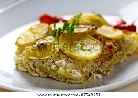 baked moussaka dish on a wooden board - stock photo