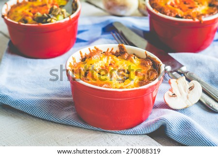 Baked mushroom julienne with cheese, vegetarian lunch on a white background - stock photo