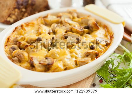 Baked mushrooms, potatoes and cheese. Vegetables closeup - stock photo