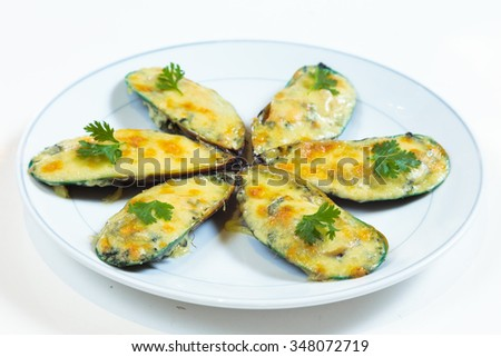 Baked Mussels European style food looks very palatable. - stock photo