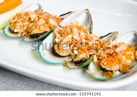 Baked mussels under cheese and garlic - stock photo