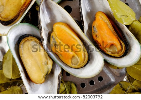 Baked mussels with kaffir lime leaves.