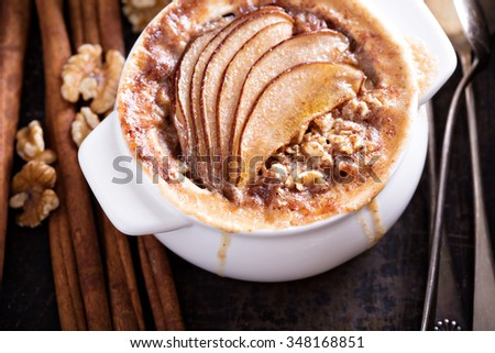 Baked oatmeal with spices and pears in small baking dish - stock photo