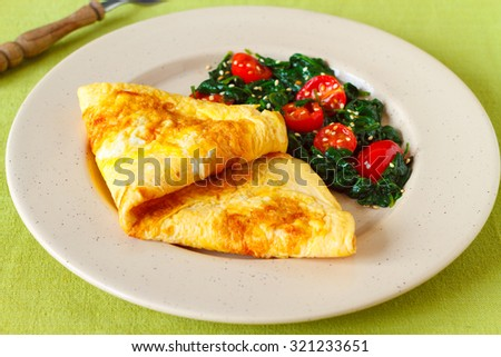 baked omelette with spinach and cherry tomatoes - stock photo