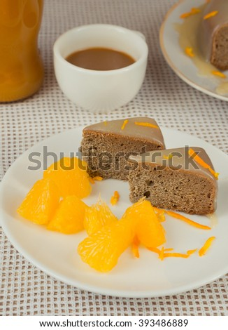 Baked orange cake with vanilla sauce and coffee