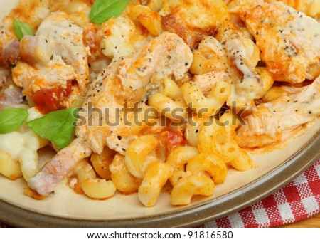 Baked pasta gratin with chicken and bacon - stock photo