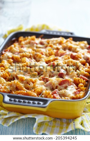Baked pasta with ham and cheesy tomato sauce