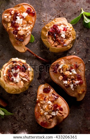 Baked Pears and Apples with Walnuts, Cinnamon, Nutmeg, Honey, Brown Sugar, Oat Crumble and Goat Cheese. Dessert Recipe - stock photo
