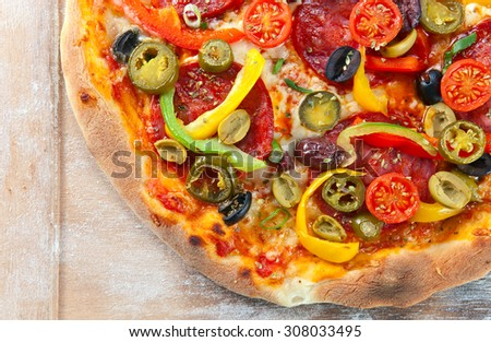 baked pizza with pepperoni , tomatoes and olives - stock photo