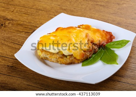 Baked pork with cream and cheese sauce