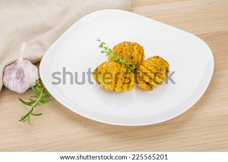 Baked potaoes with oregano on the desk
