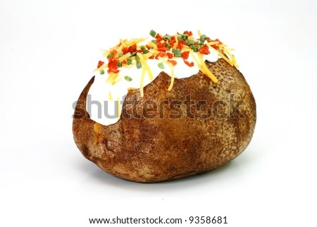 Baked potato loaded with butter, sour cream, cheddar cheese, bacon bits, and chives.  Isolated on white background. - stock photo