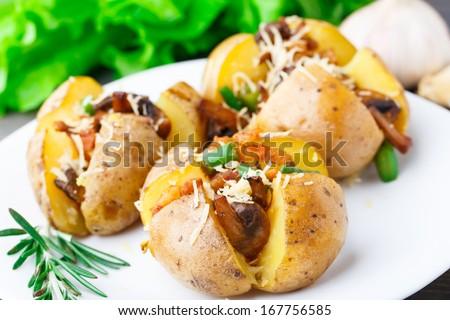 Baked potato with bacon and mushrooms - stock photo