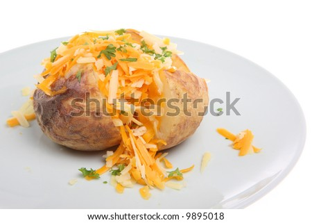 Baked potato with Cheddar and Red Leicester cheeses - stock photo