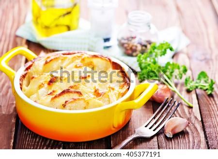 baked potato with cheese - stock photo