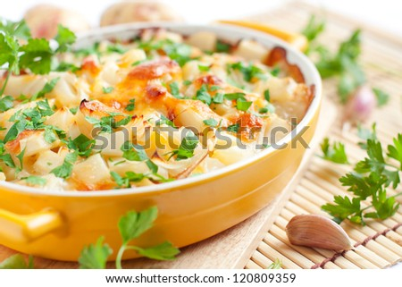 baked potato with cheese - flavored pudding, food close up - stock photo