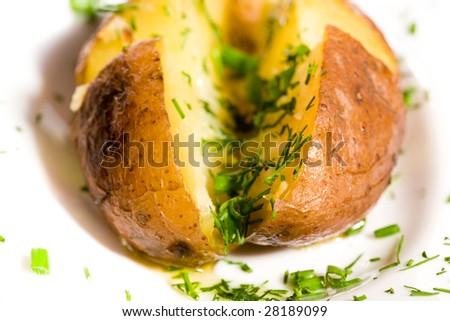 Baked potato with greens macro shot - stock photo