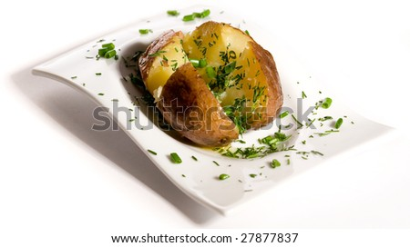 Baked potato with  greens on white plate - stock photo