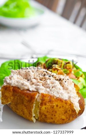 Baked potato with tuna filling and salad - stock photo