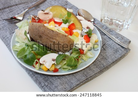 baked potato with vegetables - stock photo