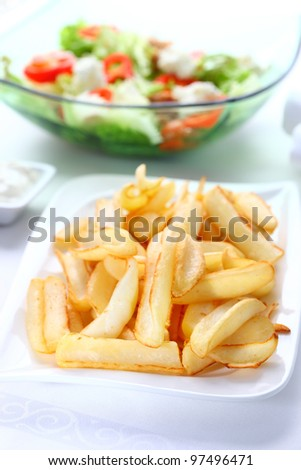 Baked potatoes with dip and vegetable salad with tunny