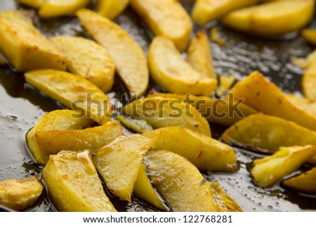 Baked potatoes with lots of oil/Baked potatoes in oil - stock photo