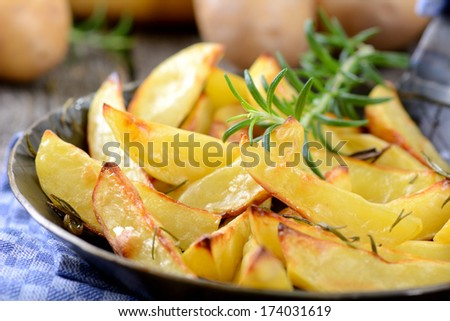 Baked potatoes with rosemary - stock photo