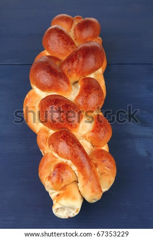 baked product : challah over blue painted wooden board - stock photo