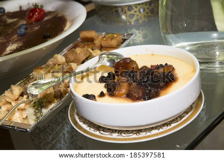 Baked pudding with apricot Arabic sweets background  - stock photo