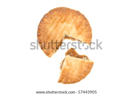 Baked puff pastry meat pie with a section cut out viewed from above - stock photo