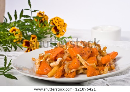 baked pumpkin and vegetable on white plate