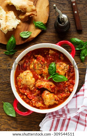 Baked rabbit in tomato sauce with rosemary and basil. Italian Cuisine.